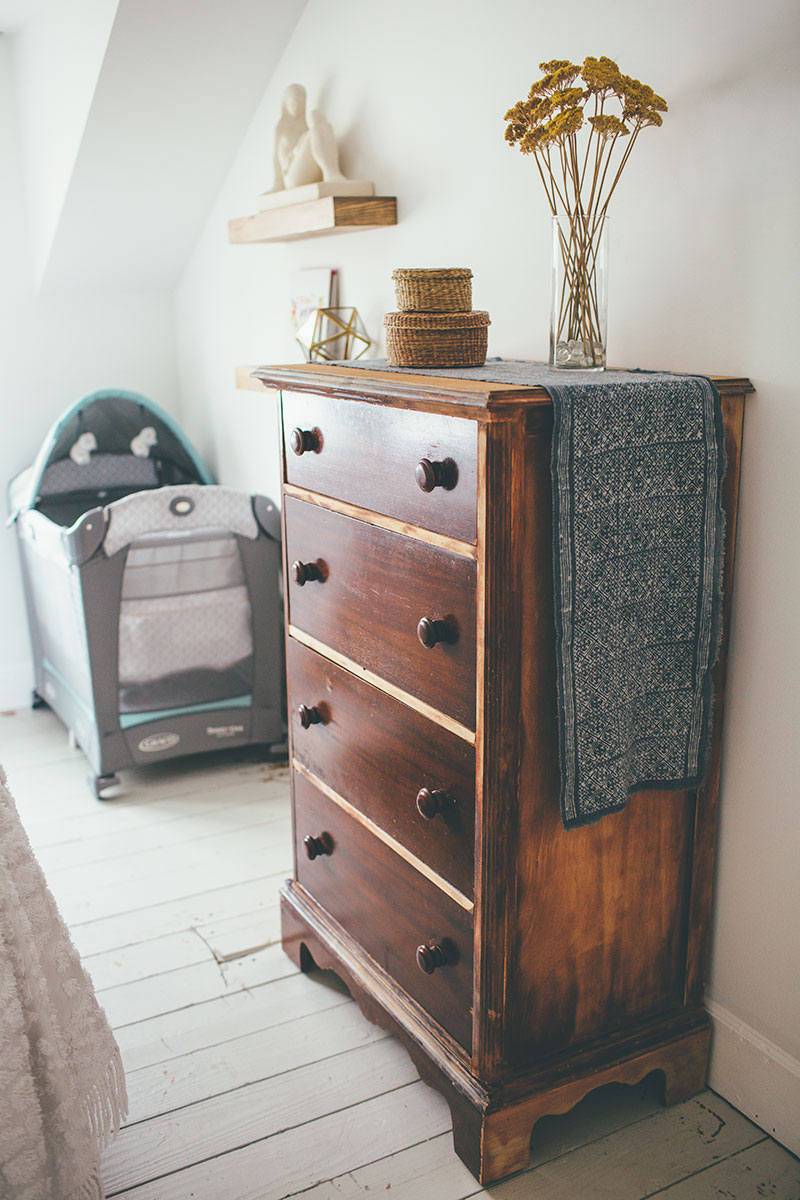 Simple Wooden Dresser with Minimalist Decor and Travel Pack n' Play
