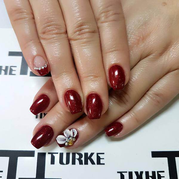 Red floral, reindeer nail design