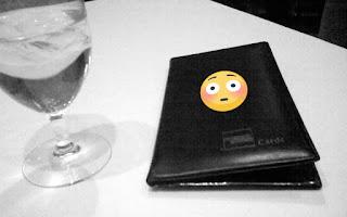 Restaurant bill with embarrassing emoji.