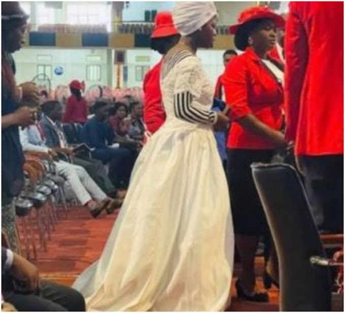 Woman 'Looking For Husband' Storms Popular Abuja Church Wearing Wedding Dress To Express Her Faith For Her Marital Breakthrough
