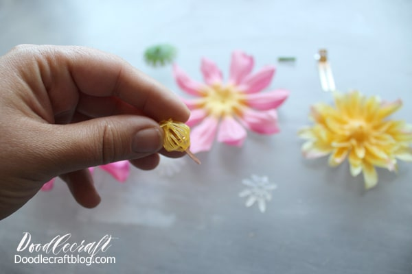 Pull the silk flower apart in layers and keep track of the order to put it together again.