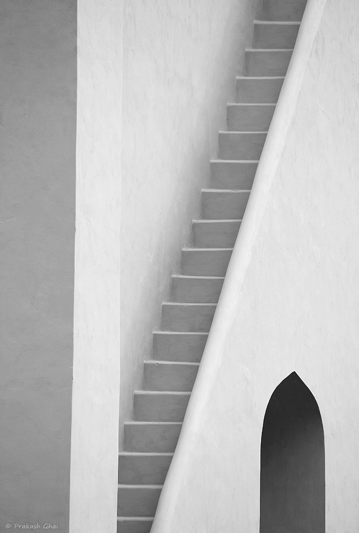 A Black and white Minimalist Photo of a Mysterious Staircase and Black Curvy Door at Jantar Mantar Jaipur