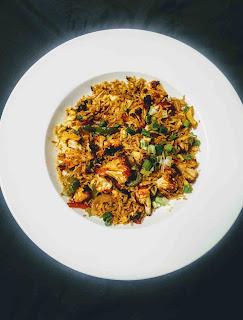 Serving cauliflower Manchurian fried rice for cauliflower fried rice Manchurian