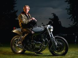 Designer with custom Royal Enfield motorcycle.