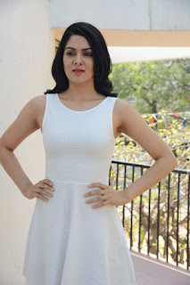 Actress Sakshi Chowdary Stills in White Short Dress at Lord Shiva Creations New Movie Launch  0003