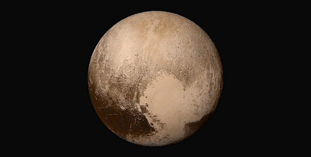 Four images from NASA's New Horizons' Long Range Reconnaissance Imager (LORRI) were combined with color data from the Ralph instrument to create this global view of Pluto. Credit: NASA/Johns Hopkins University Applied Physics Laboratory/Southwest Research Institute.