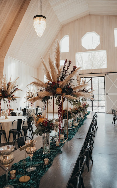 Bridal party table with tall fall flower arrangements with pampas grass