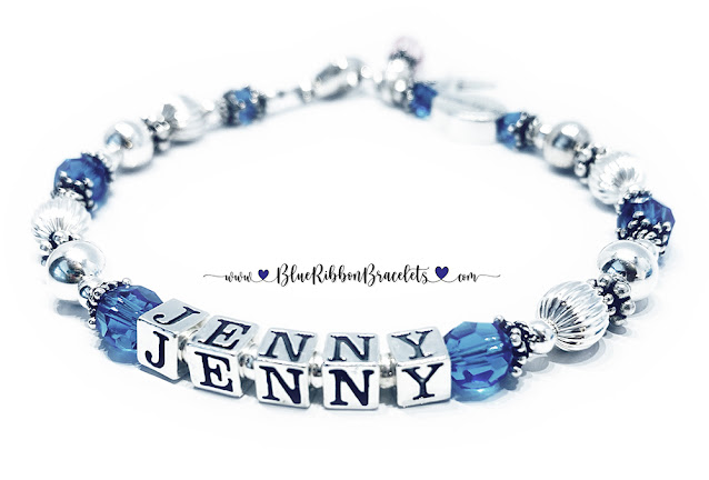 Jenny In Memory Bracelet with Blue Crystals and Pink Crystals and an In Memory Bead with a Ribbon Charm