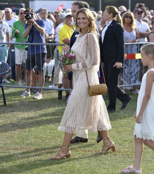 Princess Madeleine wore RED Valentino Natural Pleated Tulle Floral Print Midi Dress and Princess Sofia wore & Other Stories Tie Frill Dress. Princess Estelle