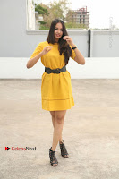 Actress Poojitha Stills in Yellow Short Dress at Darshakudu Movie Teaser Launch .COM 0295.JPG