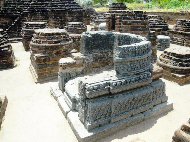 An impressive throne with many images of the Buddha carved on it at Nalanda