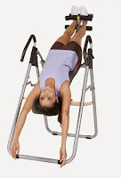 Secure ankles in ankle-lock supports & Reach hands over your head  & use gravity to invert with the Body Champ IT8070 Inversion Therapy Table