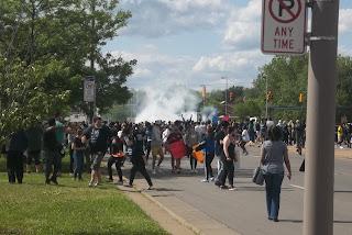 Marchers fleeing the scene.
