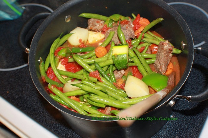 String Bean Stew in a pot with meat and potatoes