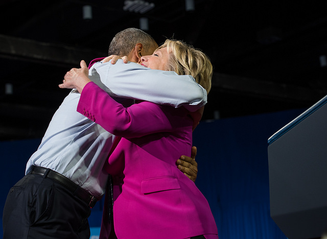 image of Clinton and Obama hugging each other