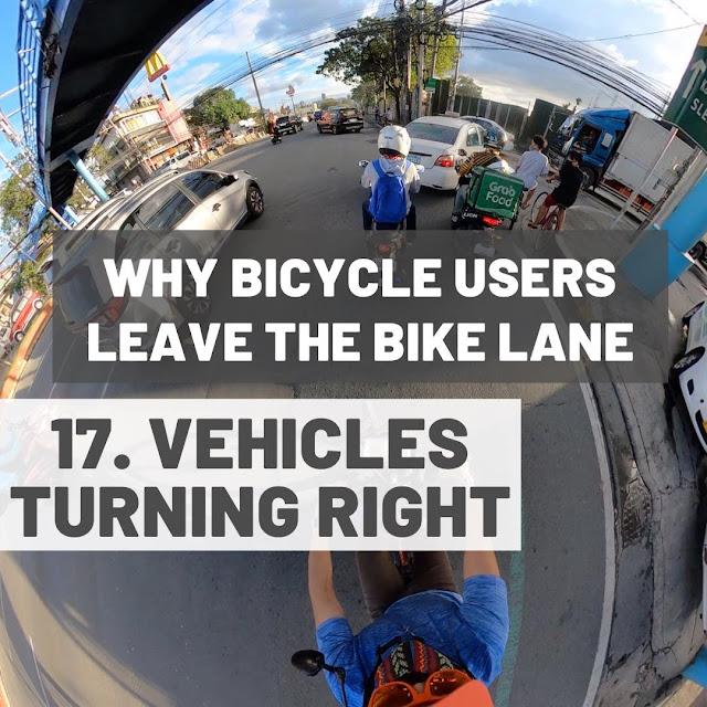 Vehicles turning right biker on bike lanes