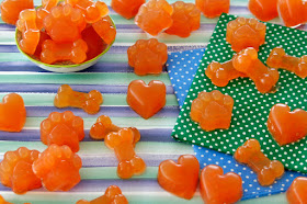 Watermelon gelatin gummy dog treats shaped like bones, paws, and hearts