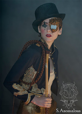 Steampunk monocle/monogoggle that looks like a brass, copper, or gold lion holding a lens. steampunk costumes and cosplay accessories
