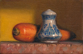 Still life oil painting of a blue and white salt shaker next to a carrot.