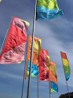 Flags against blue sky