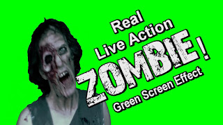 A zombie standing in front of a green screen background.