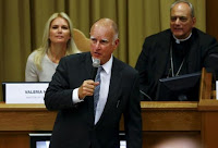 California Governor Edmund ''Jerry'' Brown (front) speaks during the ''Modern Slavery and Climate Change'' meeting at the Vatican July 21, 2015. (Credit: Reuters/Tony Gentile) Click to Enlarge.