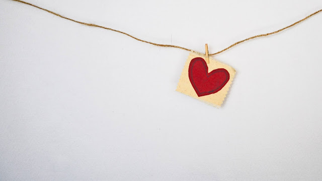 Photo by Debby Hudson on Unsplash heart on a string