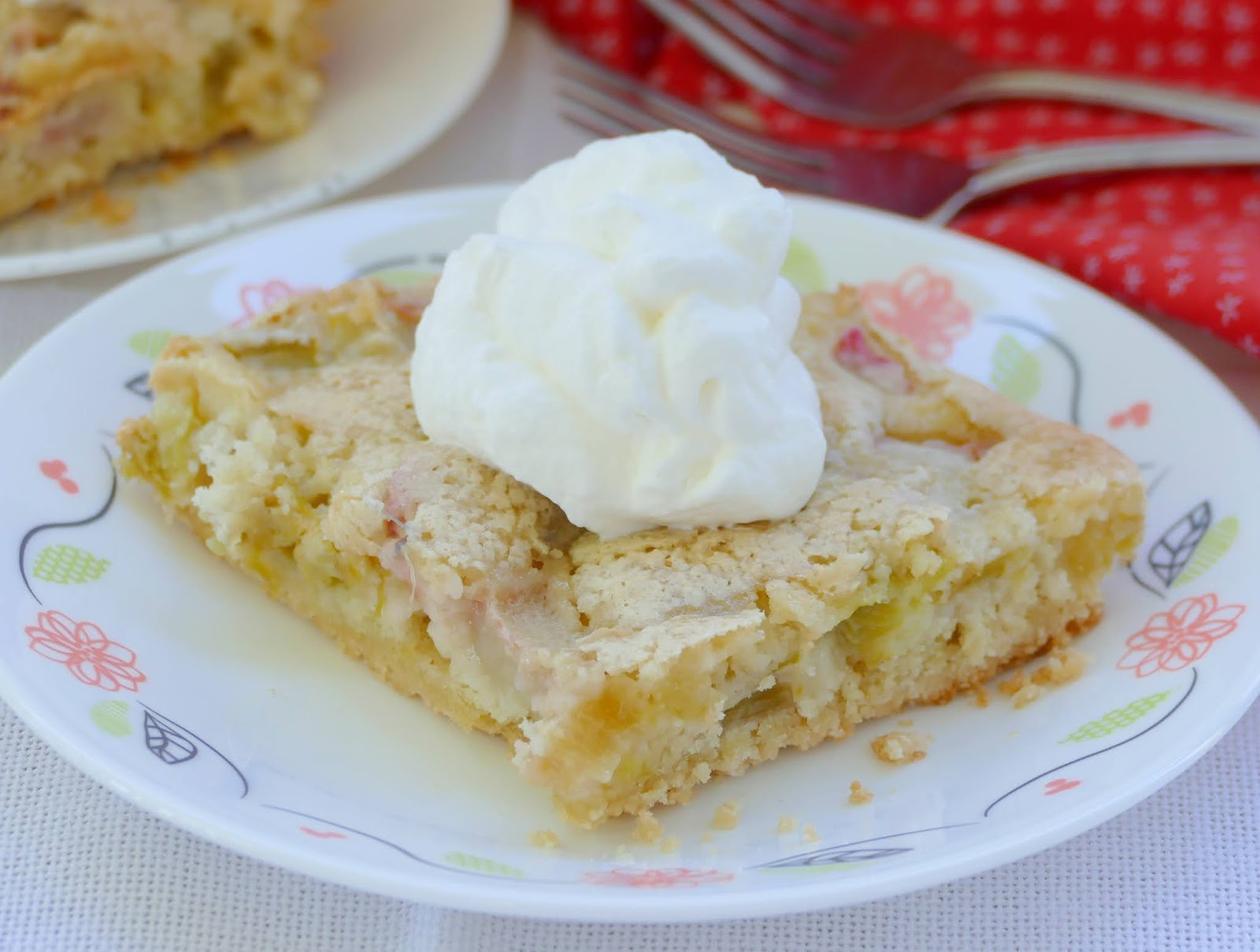 These amazing spring or summer rhubarb bars are a great potluck or party dessert! The buttery shortbread and tart rhubarb are a perfect pair and you'll find yourself wanting more than just one! Top them with whipped cream, sprinkled powdered sugar or ice cream for a wonderful, sweet treat!