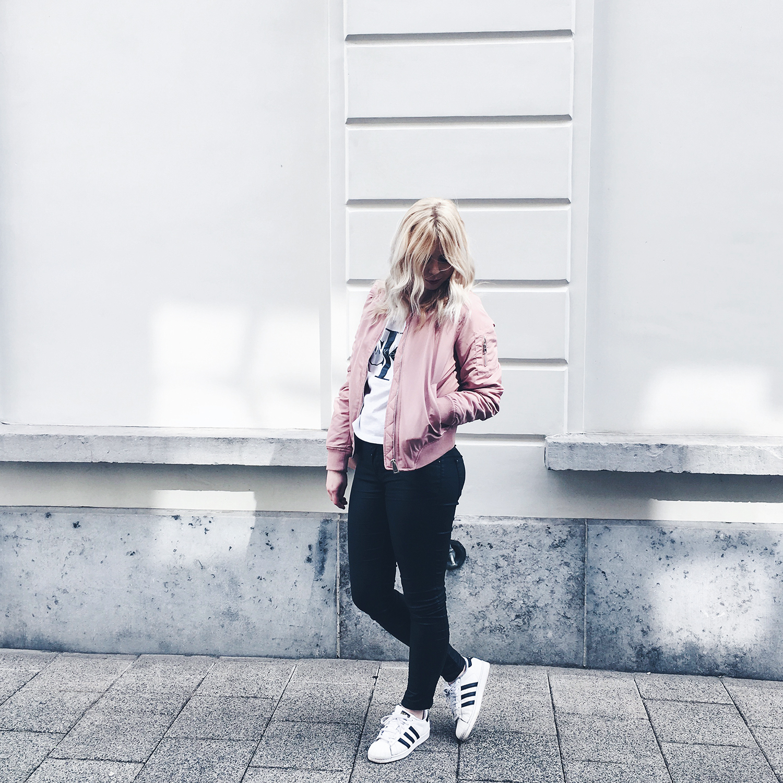 Stradivarius pink bomber jacket Zara pink backpack Calvin Klein tshirt Adidas Superstar trainers