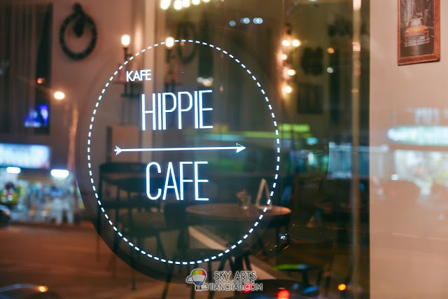 Hippie Cafe at night. Look for this sign above Tesco Express