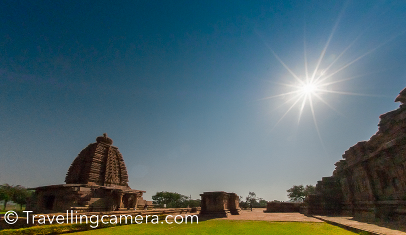 Pattadakal is 22 km from Badami and about 10 km from Aihole, both of which are well known for Chalukya  monuments. It is 514 km from Bengaluru, which is overnight journey but I am not very sure about bus connectivity.