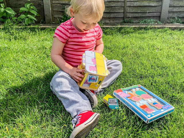 Toddler opening Wooden Peppa Pig Toys from Milly & Flynn
