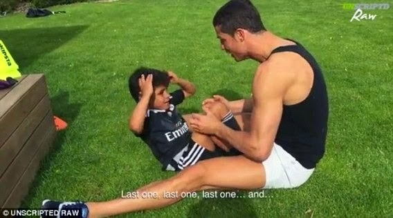 Cristiano Ronaldo does sit-ups with his son