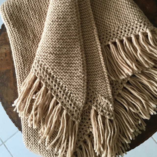 Beige knitted shawl