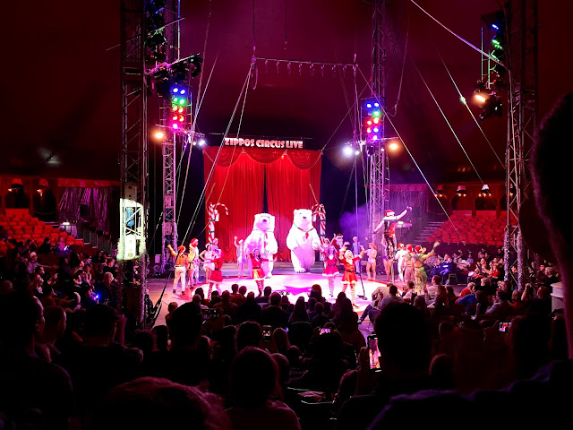 Zippos Circus finale in a tent full of people with performers on stage