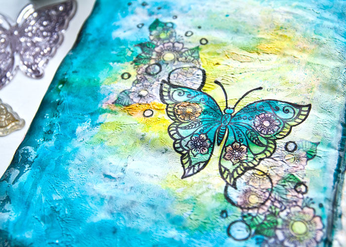 Close up of the reinker art journal page, with a video by Kim Dellow