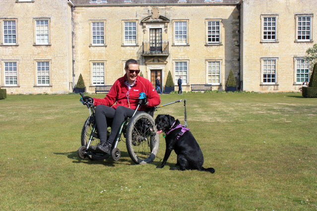 Me in my mountain trike with Liggy, my black labrador sitting by my side. We're on the big lawn with the Halls in the background.
