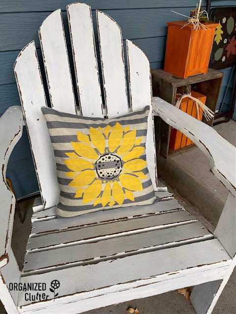 Photo of a pillow stenciled with a fall sunflower.