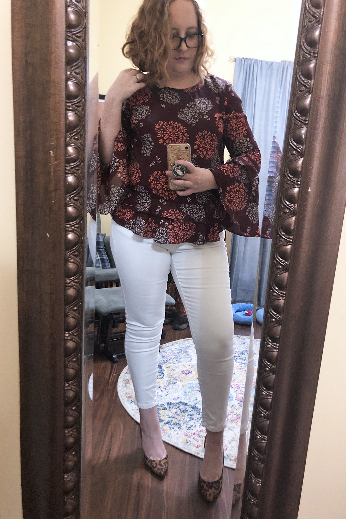 white jeans red printed blouse