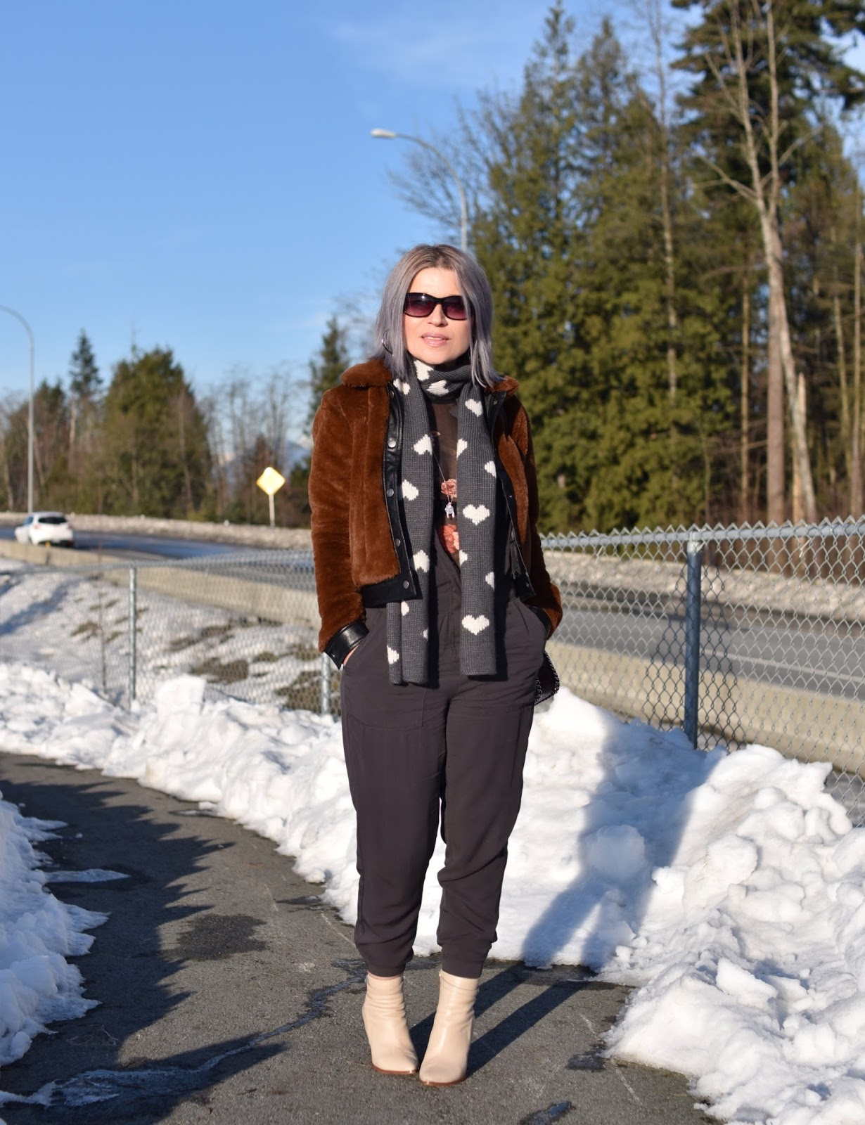 Understated:  styling a jumpsuit with a sheer floral top, teddybear bomber, and ivory booties