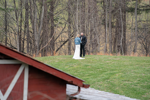Wide shot of far off Bride and Groom in distance sharing a personal moment Magnolia Farm Asheville Wedding Photography captured by Houghton Photography