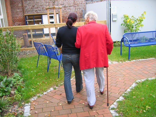 stock photo of elderly and younger woman walking