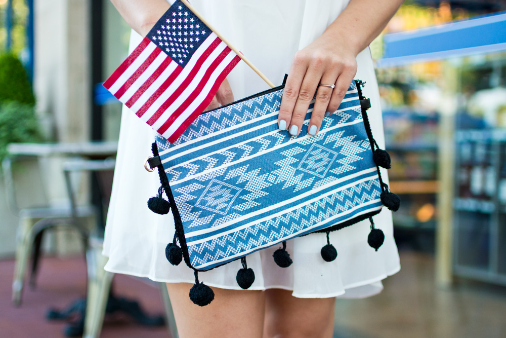 Blue pom pom clutch styled for the 4th of July