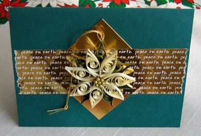 green christmas card with ivory quilled detachable poinsettia tree ornament