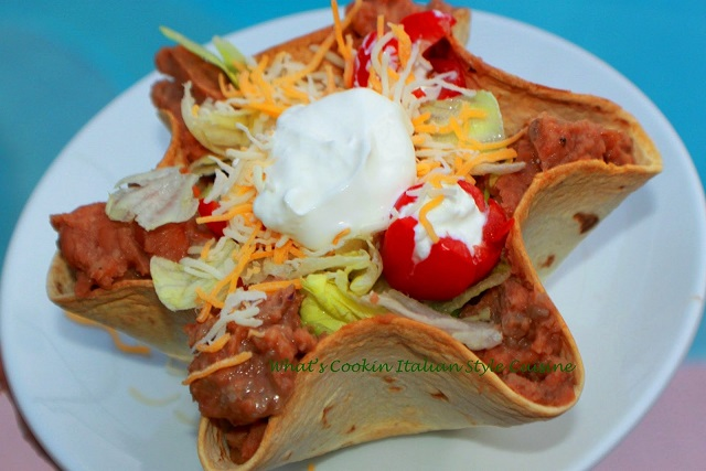 This is how to make flour tortilla taco bowls then filled with salad