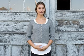 Simple cropped cardigan accent piece in gray.