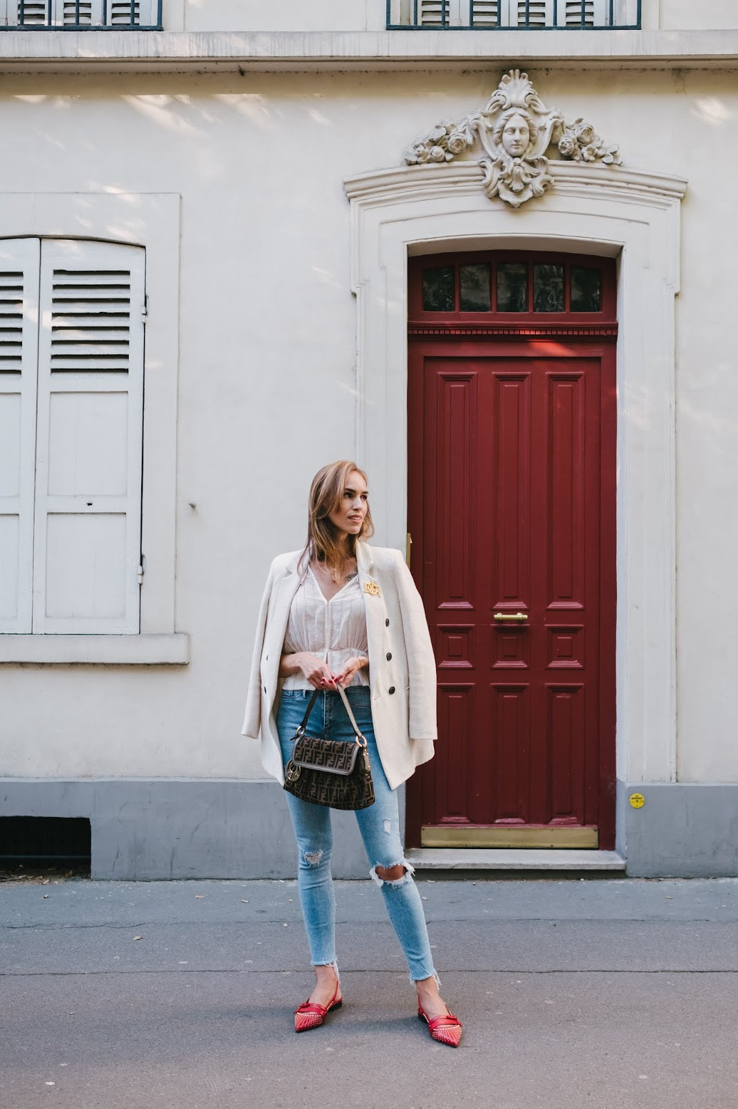 parisian street style outfit summer white blazer blue jeans