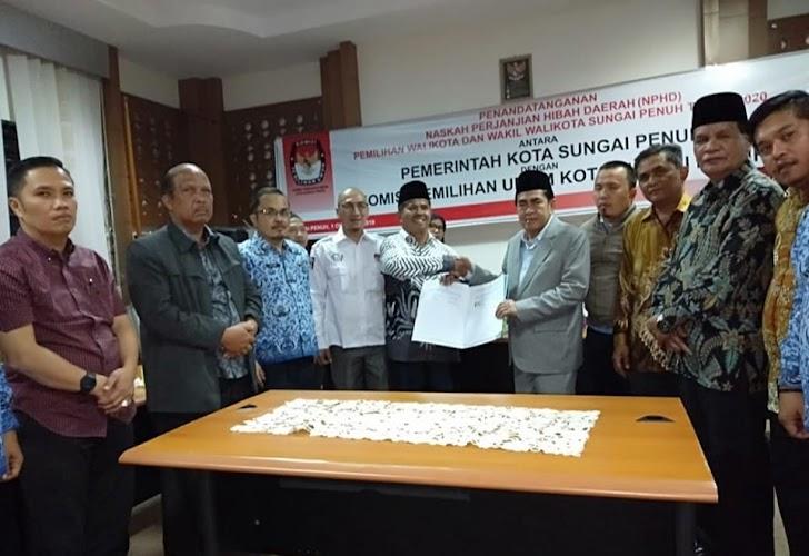 Pemkot - KPU Sungaipenuh Tanda Tangani NPHD Pilwako