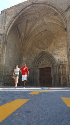 Tim and Ainhoa in front a church in Sanguesa