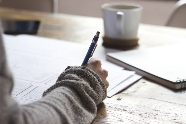a woman doing imaginative writing
